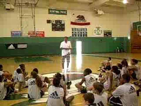 Head Coach Reggie Theus speaking at camp for kids