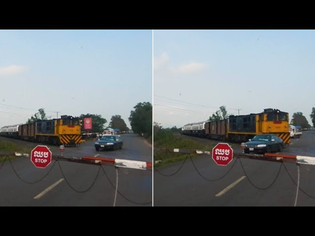 Crazy Driver JUMPS Level Crossing Barrier As Train Approaches