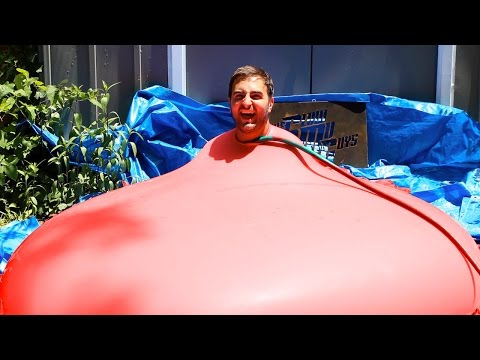 6ft Man in 6ft Giant Water Balloon - 4K - The Slow Mo Guys