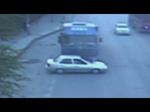 Dramatic CCTV of China car crash: Freight truck pushes car forward 500 metres