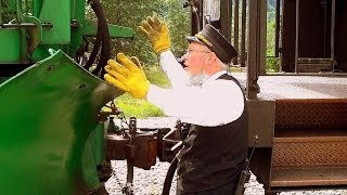 ALASKA WHITE PASS RAILWAY Head brakeman carries out brake and hose coupling of 3 diesels