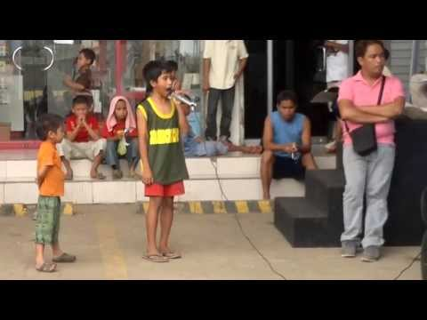 Roel Manlangit a street child singing a whitney houston song