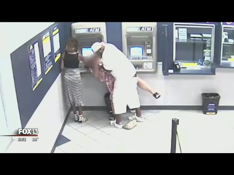 Customer looks on as man robs Tampa woman using ATM