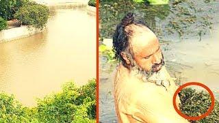 Просто невероятно, что мужчина делает в этой грязной реке...