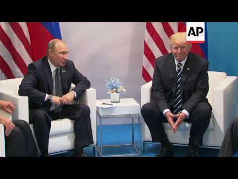Trump, Putin Hold First Face-to-Face Meeting