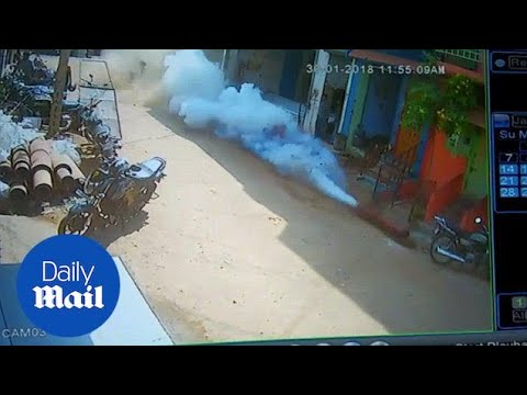 Moment man mishandles oxygen cylinder that launches like a rocket - Daily Mail