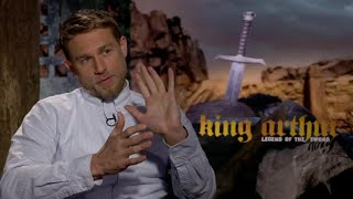 Actor Charlie Hunnam convinced director Guy Ritchie to cast him in his 'King Arthur' movie over a long conversation about medical marijuana. He also talks about his laid back co-star, Djimon Hounsou.