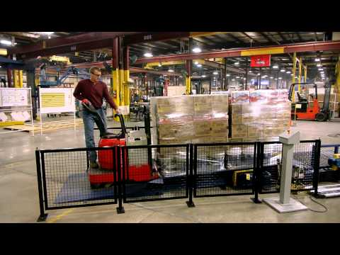 lantech's-floor-loaded-conveyor-and-pallet-truck-ramp-system