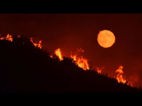 Fires ravage Southern California amid record heat