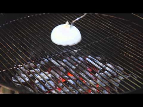 How to clean a grill using an onion and a fork
