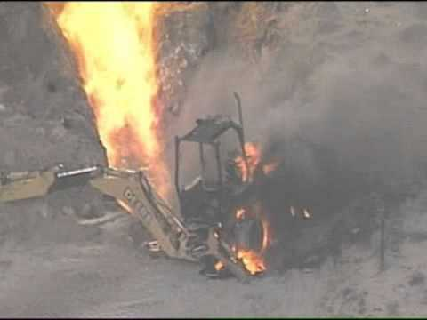 Backhoe ignites gas-line fire