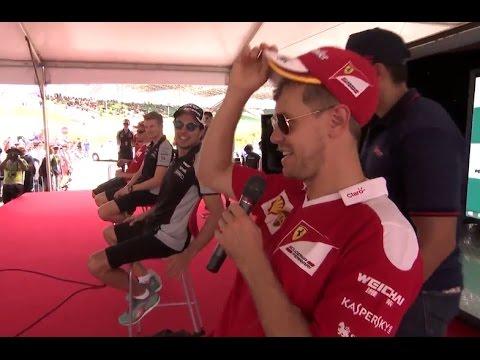F1 2016 Malaysian GP - Sebastian Vettel gives a fan his own Ferrari cap