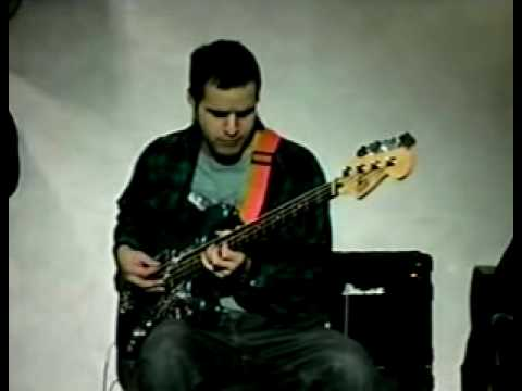 playing a bass guitar by william arnold