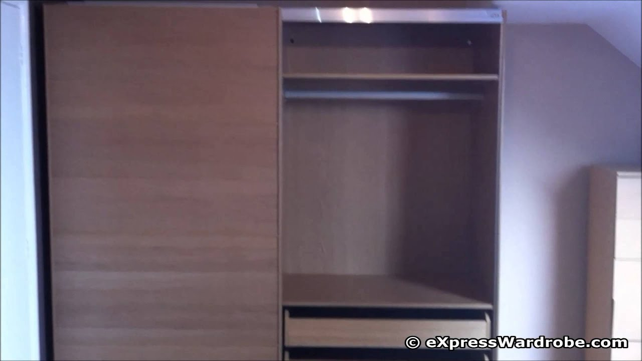 Ikea pax malm sliding door wardrobe design with interior chest of drawers youtube Home interior wardrobe design