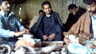 Garhee Matani. Rabab and mange (pitcher) music in a hut.