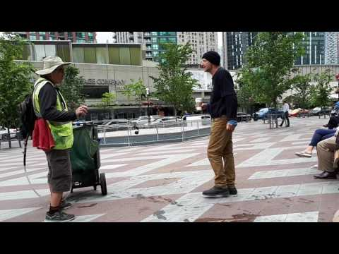 Crazy guy attacks municipal worker in Toronto