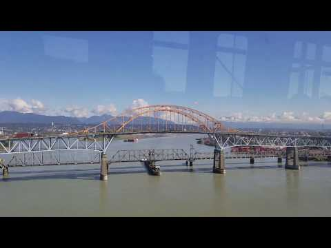 Vancouver SkyTrain Moment: Crossing Fraser River on the Expo Line, Sunny Day - 4K