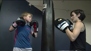 Never down for the count: Boxing lessons bring confidence, strength to little boy