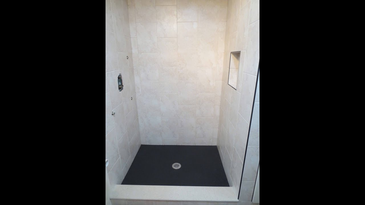 Vertical running bond tile shower install - YouTube