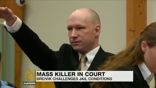 Anders Breivik returns to court with a Nazi salute