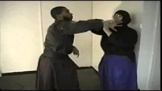 Kunoichi Female self defense being held against wall 2