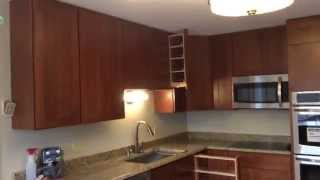 Kitchen With Spice Racks And Movable Island