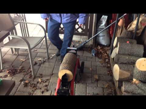 Carol splitting logs on Homelite splitter