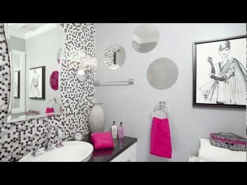 Remodeled bathroom designed for a teenage girl features penny-round tiles and hot pink accessories