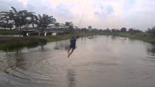OMG! Girl wildly swinging on a wakeboard cable