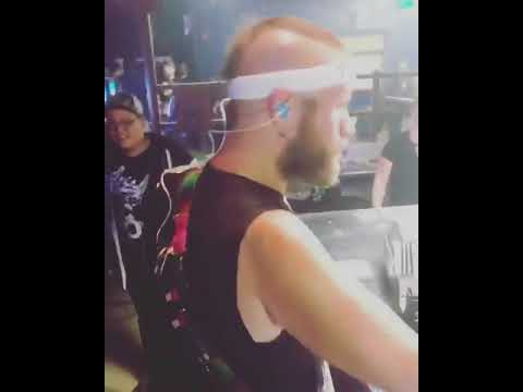 """Adam D. getting a shot of Whiskey while Killswitch Engage was performing """"End Of Heartache""""."""