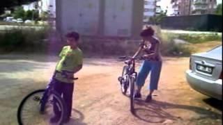 BillyWatson.TV - Aynur and Boy bike riding.