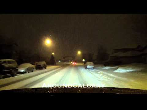 Driving in Calgary at Night Time, Snowing NW to NE Country Hills