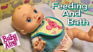 Baby alive video boy wets n wiggles feeding bathing and changing- featuring BOB