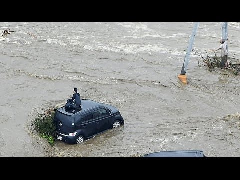 At least 8 missing and 90,000 evacuated in Japan floods