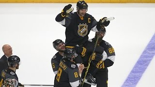 Team Pacific lifts captain John Scott after victory
