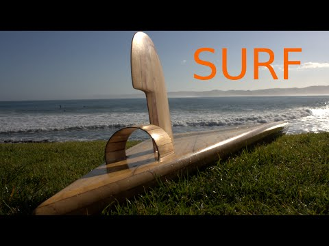 Wooden surfboard riding