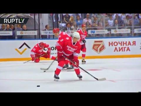 Putin hits the ice & shows off his hockey skills in Sochi
