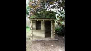 Hand Made Traditional Log Cabin Playhouse With Grass Roof Part 1.wmv