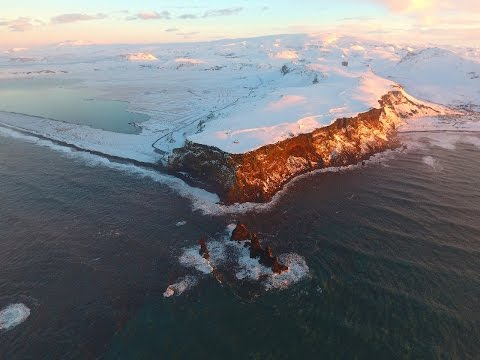 Black Sand Beach Reynisfjara Vik Iceland Aerial 4K - World Travel Adventurers