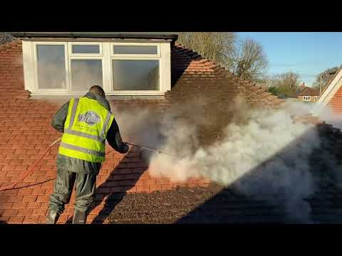 Doff Roof cleaning, removing a heavy build up moss from a red tiled roof using the doff system
