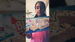 Putting whipped cream in little Debbie bday cakes