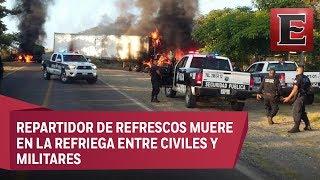 Enfrentamiento en Tomatlán, Jalisco, desencadena bloqueos y quema de camiones