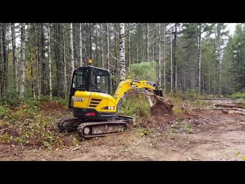Sany sy35u mini excavator review and pushing over trees.