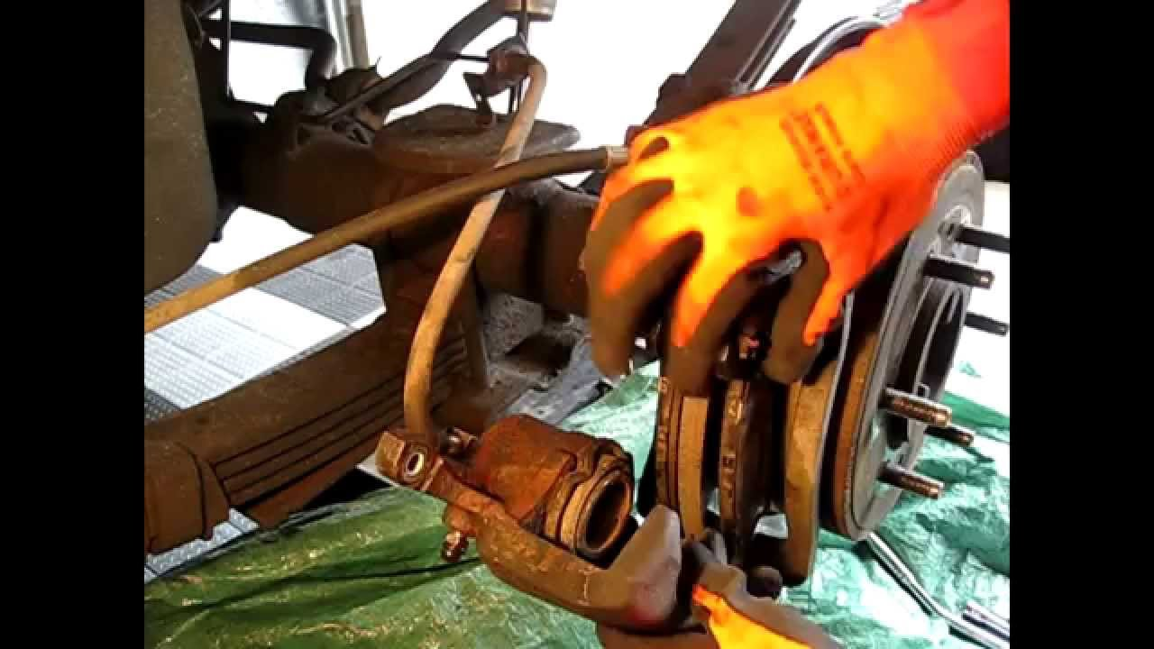 How to Replace Install Rear BRAKE PADS on Hummer H3 ...