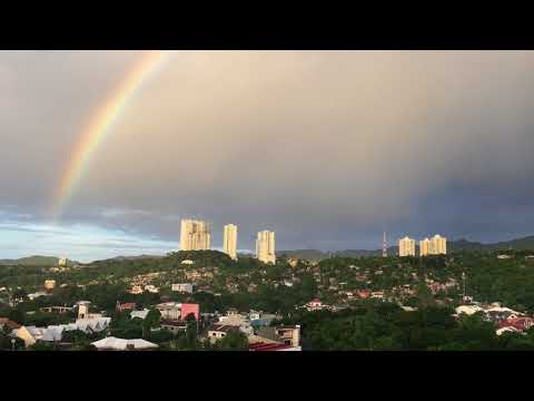 Beautiful rainbow over the city of Cebu, Philippines