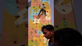 Climbing on the wall in flying elephant adventure park at kanpur