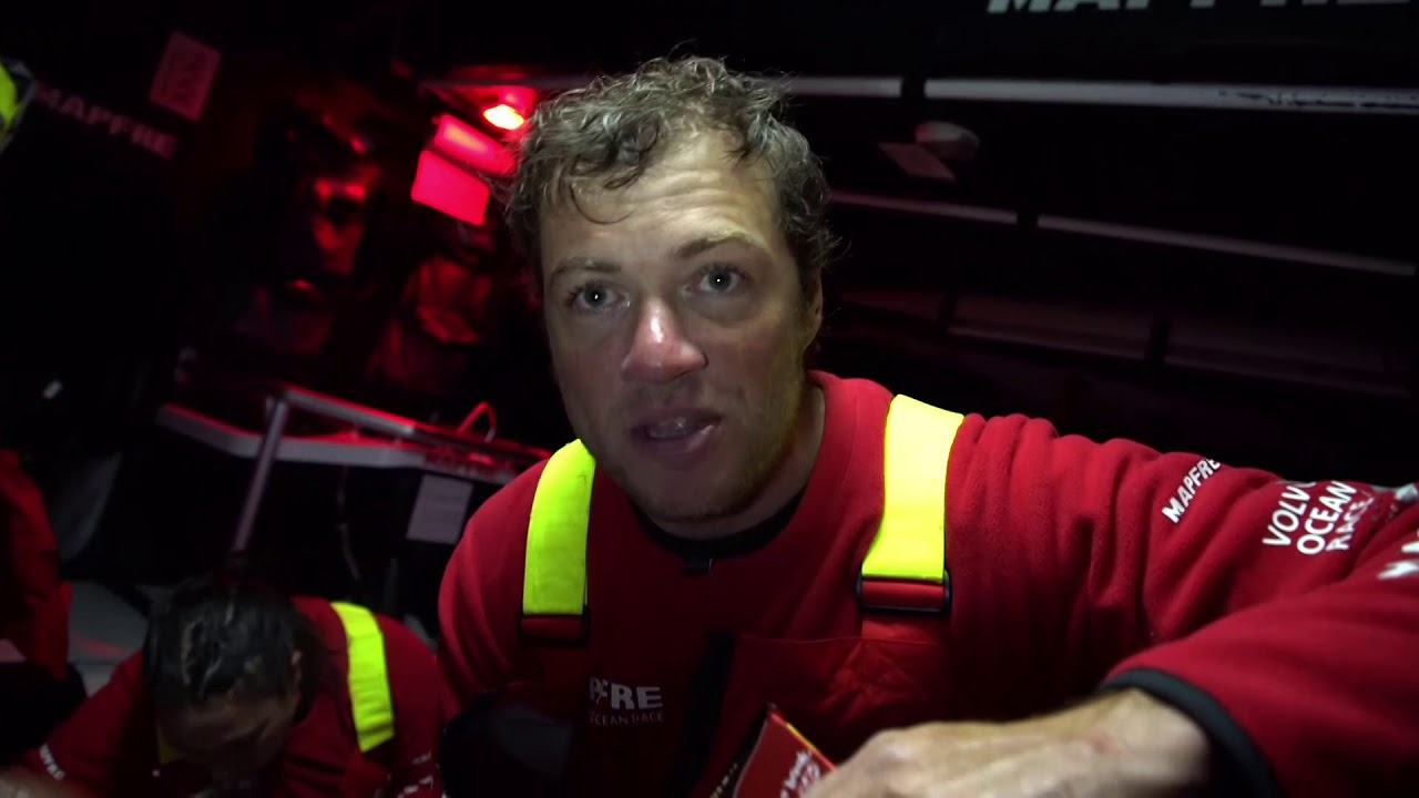Rob, below, explains everyone trying to maintain a southerly position. Other boats nearby. 20-25 knots right now, then they'll come down to the ice barrier and gybe. Neti: Second in the fleet right now. Exciting; they passed Vestas. Pablo (something) on the wheel. Fighting with Dongfeng. After 4 or 5 days in the ocean, are 3 boats fighting within a mile. Found a bit of a fast mode today compared to Vestas. We'll see how it goes. Shot of two boats in teh sunset on their weather quarter. Slomo shots of the sunset, other boats. Xabi, below, talks in Spanish about the other boats.