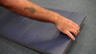 Tapping bottom of mats to prevent moving on carpet