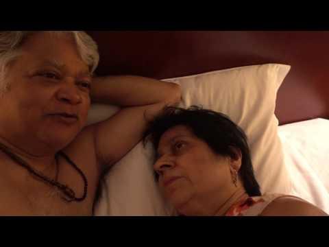 Aruna & Hari Sharma relaxing in Bed Executive Rm 1006 Rosedale Hotel & Suites Beijing, Apr 26, 2017