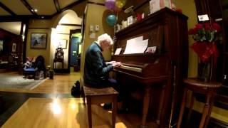 Marjorie Redmond on her 100th birthday piano